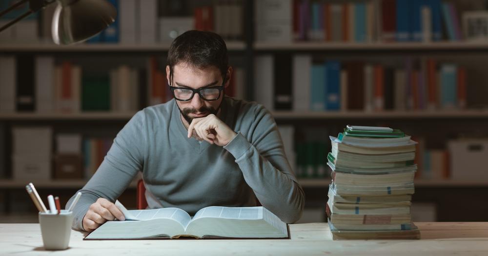 man reading in